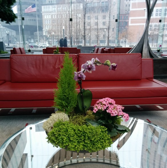 a pretty flower arrangement in the lobby of the Boston Fed.